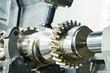 Leinwandbild Motiv cogwheel on shaft milling process. Industrial CNC metal machining by vertical mill
