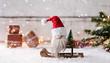 Leinwanddruck Bild - Kleiner Weihnachtsmann sitzt auf seinem Schlitten und wünscht frohe Weihnachten