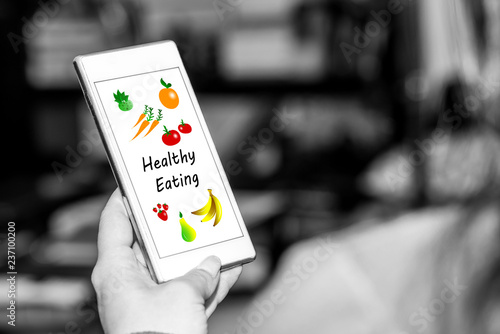 Foto Murales Healthy eating concept on a smartphone