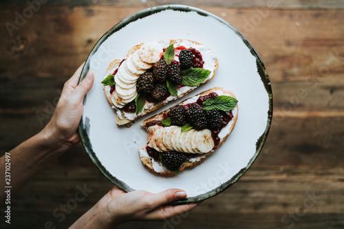 Leinwanddruck Bild Toast with blackberry jam and vegan cream cheese