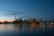 Skyline of Toronto at sunset with colorful reflections on the water