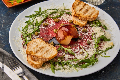 Beef Carpaccio with Parmesan and Croutons. - 237116835