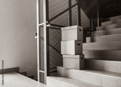 Moving Boxes Stay On Stairs In House Image In Black And White