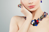 Jewelry woman. Colorful necklace, ring and earrings portrait