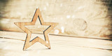 THe wooden star on the wooden desk