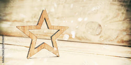 THe wooden star on the wooden desk - 237130669