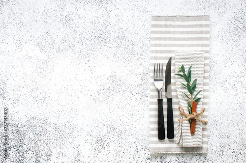 Linen napkin, sprig and cinnamon on light background - 237143402