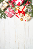 Red and Gold present box and decorations on white wooden backgro - 237144042