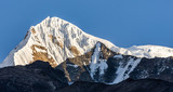 Snowcapped Mountain Summit against blue sky in the Himalayas of Nepal - 237148094