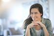 Leinwanddruck Bild -  Portrait of stunning brunette smiling indoors