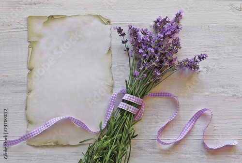 Lavender flowers  with paper on wooden background  - 237183072