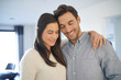 Leinwanddruck Bild -  Portrait of gorgeous couple embracing at home