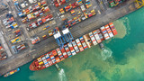Container ship in export and import business and logistics. Shipping cargo to harbor by crane. Water transport International. Aerial view and top view. - 237191681