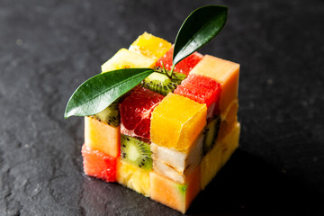 Fruit cube on white background © George Dolgikh
