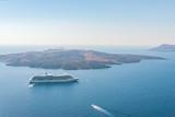 Cruise ship and boats close to the Santorini island. Greece.