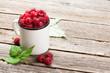 Leinwanddruck Bild - Cup of ripe raspberries