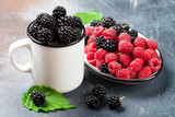 Cup of ripe blackberries and raspberries