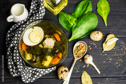 green sorrel soup with egg in a glass plate and spices - 237225090