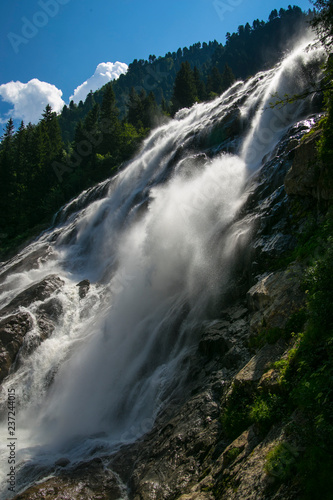 Valley in the Alps (Austria, Europe). Beautiful nature, high mountains, summer day, snowy peaks. Hike in the rocks, traveling with a backpack. - 237244015