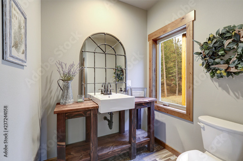 Fantastic bathroom boasts a country style wooden washstand