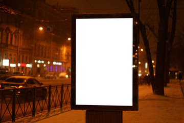 city outdoor billboard mockup Glows in the darkness of the night city winter. © Alex