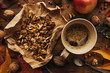 Enjoying fruits of autumn - apple, coffee and walnut on table