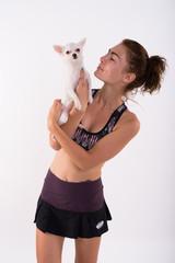 Studio shot of beautiful teenage girl standing while holding and