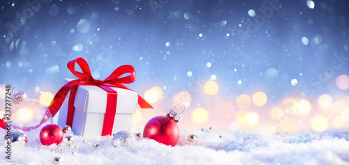 Christmas GiftBox With Bow On Snow