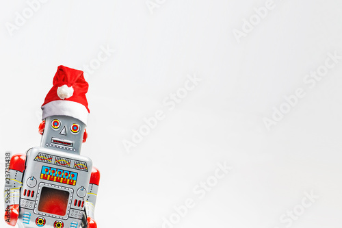 Leinwandbild Motiv Vintage robot retro classic toy with Christmas hat on white background