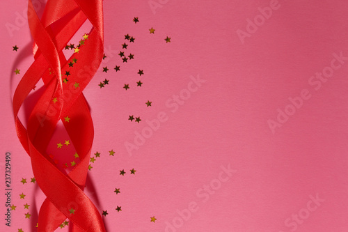 Pink curled ribbon at pink background for celebration decoration - 237329490