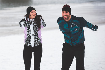 Enthusiastic Love Couple Exercising Outdoors