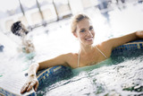 Portrait of beautiful woman relaxing in swimming pool - 237341892