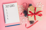 2019 Goals, top view brown gift box, notebook and christmas decoration for new year on pink pastel color. - 237342642