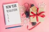 New Year Resolution, top view brown gift box, notebook and christmas decoration for new year on pink pastel color. - 237342698