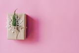 Brown gift box on the pink background. Minimal styled holiday card with copy space. - 237342822