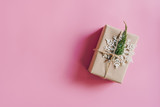 Brown gift box on the pink background. Minimal styled holiday card with copy space. - 237342837