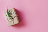 Brown gift box on the pink background. Minimal styled holiday card with copy space. - 237342847