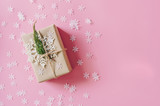 Brown gift box on the pink background with christmas decoration. Minimal styled holiday card with copy space. - 237343005