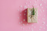 Brown gift box on the pink background with christmas decoration. Minimal styled holiday card with copy space. - 237343646