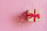 Brown gift box on the pink background with christmas decoration. Minimal styled holiday card with copy space. - 237343670