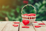 Red heart in basket on wooden table for valentine day and love concept with copy space. - 237343809