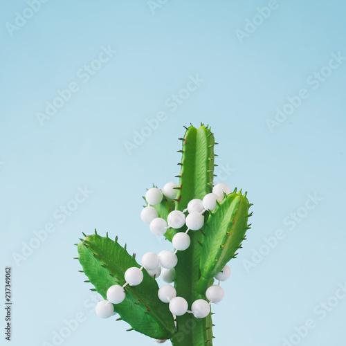 Leinwanddruck Bild Cactus with Christmas tree decoration. Minimal New Year concept.