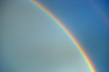 RAINBOW IN BLUE SKY AFTER RAIN © danheighton