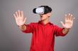 Persian teenage boy using VR glasses for virtual reality
