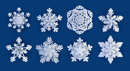 Vector set of 8 white Christmas paper cut template snowflakes with shadow on  blue background. New year design elements © samserius
