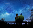 couple watching the stars in night sky