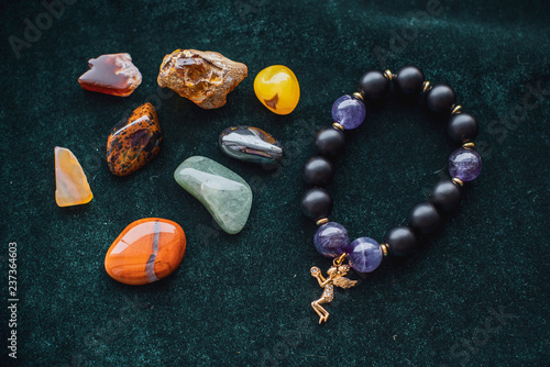 Various colorful stones quartz, marbles, ore minerals, gems use as ornament and decoration jewelry that contain spiritual force human believes, magical stones  - 237364603