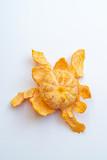 A peeled mandarin isolated on white