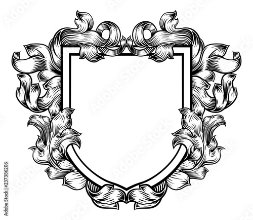 A coat of arms crest heraldic medieval knight or royal family shield. Vintage motif with filigree leaf heraldry.