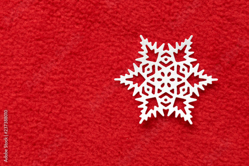 fototapeta na ścianę white paper snowflake background made of red fleece. the concept of Christmas